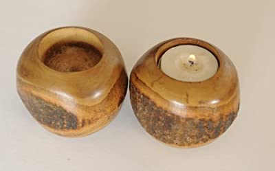 set of two hand carved candle holders(made from rough mango wood)