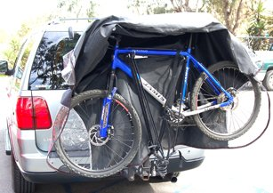 Dual Bike cover for transport on rack , for 1-2 bikes. with clear see through PVC for the tail light. Cover size :84″ L x 36″ W X 52″/42″H