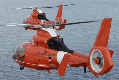 Two Coast Guard Hh-65C Dolphin Helicopters Fly In Formation Over The Atlantic Ocean Wall Decal - 18 Inches W X 12 Inches H - Peel And Stick Removable Graphic front-813781