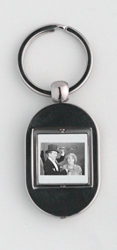 Key ring with A magician is showing magic in which he shows that a girl emits out an egg from her mouth