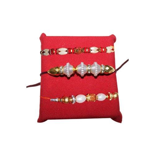 handicrunch-rakhi-set-of-3-beautiful-pearl-rakhis-set-with-haldiram-soan-papdi