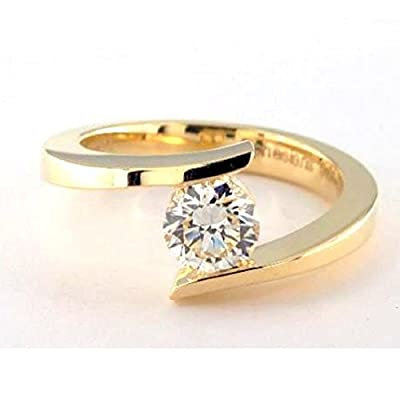 Beautiful 0.10 Carat Tension Set Round Diamond Solitaire Engagement Ring, 9k Yellow Gold