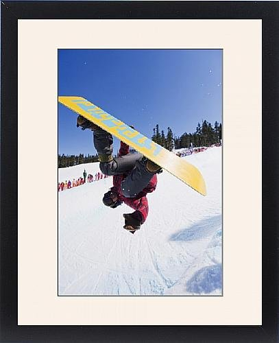 framed-print-of-a-snowboarder-jumping-at-telus-half-pipe-competition-2009