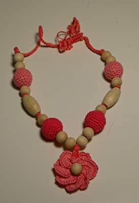 Wooden Organic Teething Necklace features with a Pink Flower