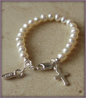 Sterling Silver Girls Bracelet for Baptism & Christening, Pearls with Cross. This dainty christening bracelet is made of genuine sterling silver and genuine freshwater pearls adorned with a precious little silver cross (Size Small, 0-12 months adjustable).