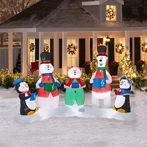 CHRISTMAS DECORATION LAWN YARD INFLATABLE CAROLERS MUSICAL LIGHT SHOW INCLUDES REMOTE CONTROL AND BATTERIES 7' TALL X 10' LONG