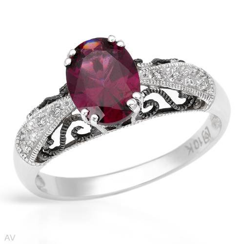 White Gold 0.03 CTW Color G-H SI2-SI3 Diamond and 1.4 CTW Rhodolite Garnet Ladies Ring. Ring Size 6.5. Total Item weight 2.3 g.
