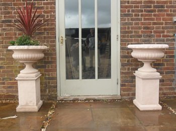 A pair of ornate stone Victorian Urn, planters Without Plinths