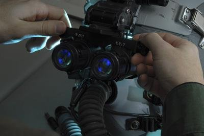 Adjusting Wall Decals Airman Adjusts The Eyespan On A Pair Of Night Vision Goggles - 24 Inches X 16 Inches - Peel And Stick Removable Graphic