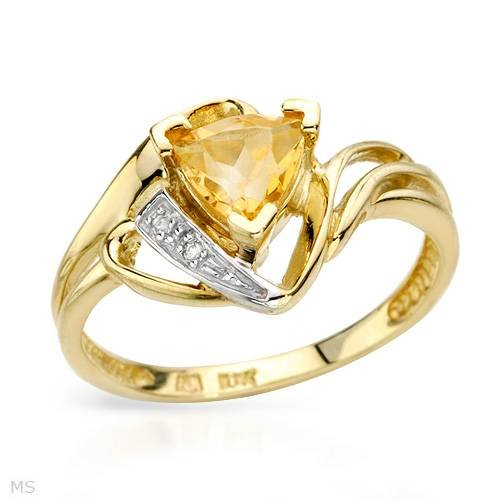 Yellow Gold 0.84 CTW Citrine and 0.01 CTW Accent Diamond Ladies Ring. Ring Size 7. Total Item weight 2.5 g.