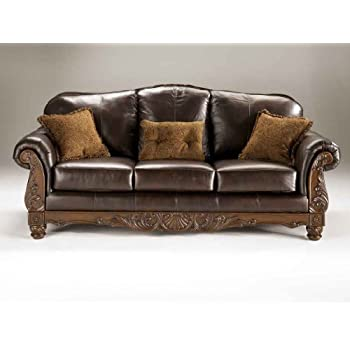 "Ashley North Shore 2260338 95"" Stationary Sofa with Top-Grain Leather Upholstery 3 Pillows Included Carved Details and Rolled Arns in Dark"