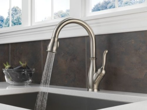 Delta Leland is a typical Pull-Down kitchen faucet with magnetic sprayer docking
