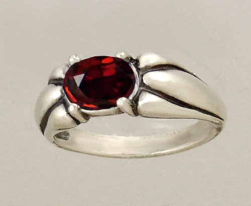 A Lovely Sterling Silver Ring Featuring a Beautiful Faceted Garnet Gemstone