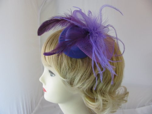 Cute mini purple top hat fascinator with net bow and feather decoration set on clip. Ideal for wedding, ladies day or any other special occasion