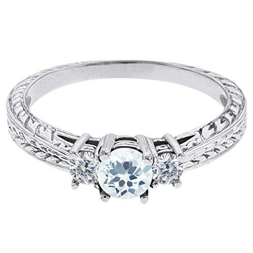 0.57 Ct Round Sky Blue Topaz G/H Diamond 18K White Gold 3-Stone Ring