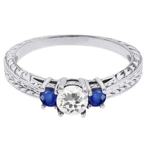0.59 Ct Round White Topaz Blue Sapphire 18K White Gold 3-Stone Ring