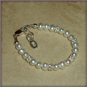 Victoria Sterling Silver Childrens Girls Bracelet Jewelry NEW! Luxurious sterling silver bracelet with beautiful soft white freshwater pearls accented with shimmering silver daisies. A keepsake she will cherish forever! Size Large 6-13 Years