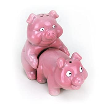 Fun and functional salt and pepper shaker set. These frisky pigs are up to no good. Each adorably little piggy is actually a functionally salt or pepper dispenser