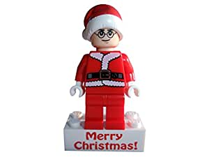 Lego minifigure in santa father christmas outfit on merry christmas
