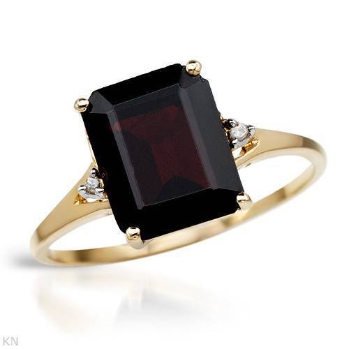 Yellow Gold 3.94 CTW Garnet and 0.01 CTW Accent Diamond Ladies Ring. Ring Size 7. Total Item weight 1.9 g.