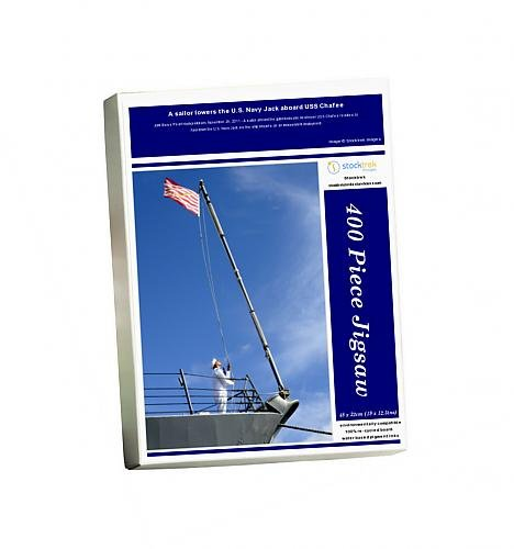 photo-jigsaw-puzzle-of-a-sailor-lowers-the-us-navy-jack-aboard-uss-chafee