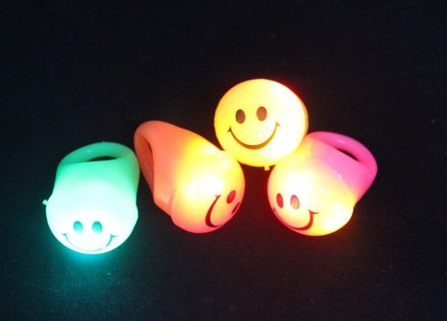4Pcs - Led Flashing Light Imitation Ring - Smile Face Rings - Bling Blinking Spinning Led Rings -Fashionable Assorted Colors By Melody