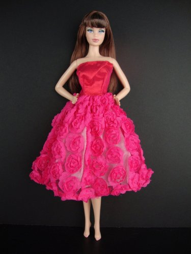 A Hot Pink Knee Length Dress Covered in Roses It so Cute Also Avail in Silver, Red, and Purple Made to Fit the Barbie Doll