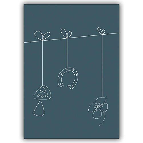 1 Silvesterkarte: Verschicken Sie zu Silvester eine Leine voll mit Glücksbringern