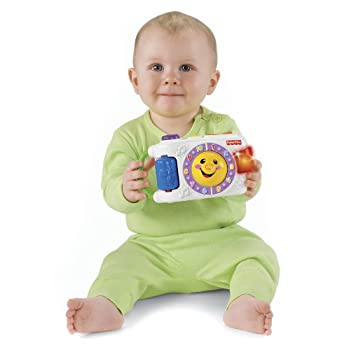 Baby is sure to smile, laugh and sing with this friendly light-up camera. Four sing-along songs help baby learn about counting, colors, feelings and more. There's a ball to bat and roll, beads to spin, toggle to press, and plenty of fun in the pictur...