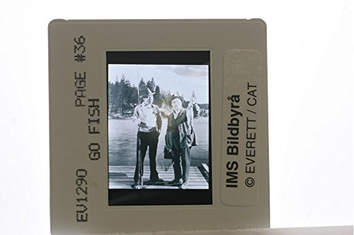 slides-photo-of-two-man-standing-on-a-riverside-and-a-man-holding-a-fish
