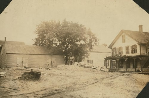 1912 child labor photo Cottage Street hovels down by the river in which a great deal of home work is
