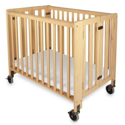 Foundations' HideAway Easy Roll Compact Fixed-Side Folding Crib in Natural foundations of systems biology