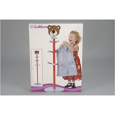 Clothes pole with teddy bear face on top