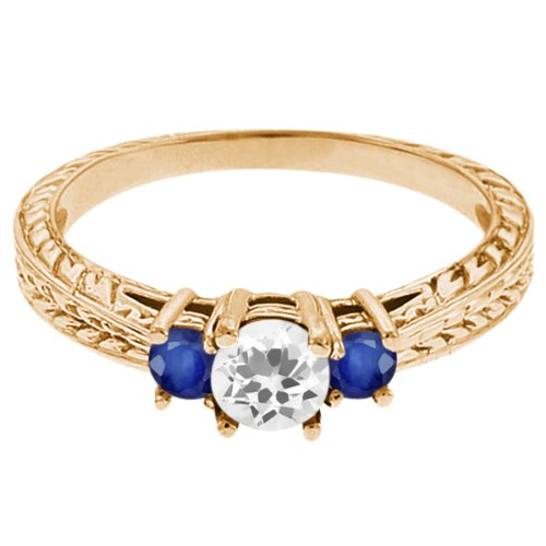 0.59 Ct Round White Topaz Blue Sapphire 18K Yellow Gold 3-Stone Ring