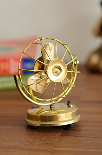 eCraftIndia Brass Antique Table Fan Showpiece available at Amazon for Rs.395