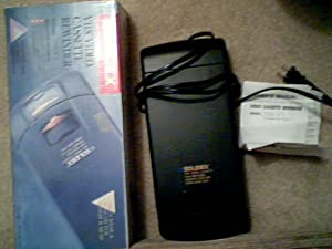 1993 Solidex, Inc. Solidex Performance Solidex VHS Video Cassette Rewinder Model# 958XT Solidex 958XT Solidex VHS Video Cassette Tape Rewinder Automatic Stop/Eject System Model 958XT (Black Color)