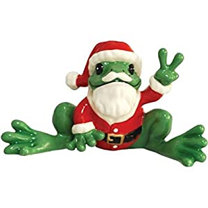 Green Frog Figurine Wearing Santa Claus Outfit Holds Up Peace Sign