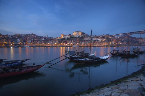 wallmonkeys-boats-carrying-wine-barrels-in-oporto-harbor-at-dusk-peel-and-stick-wall-decals-wm348592