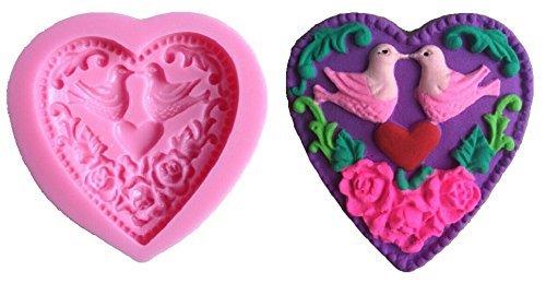 stampo-in-silicone-per-uso-artigianale-rappresentante-il-calco-di-un-cuore-con-2-colombe-allinterno