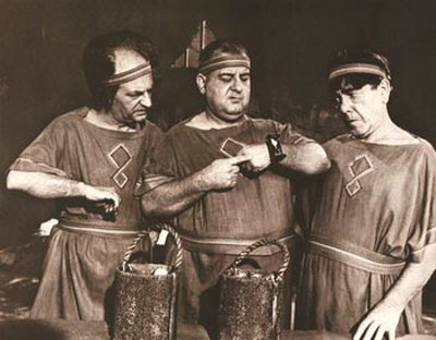 Larry, Curly Joe DeRita, and Moe in a scene from The Three Stooges Meet Hercules
