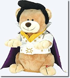 Rock and roll singer Elvis Presley holds a stuffed animal ... |Elvis Presley Stuff Animal