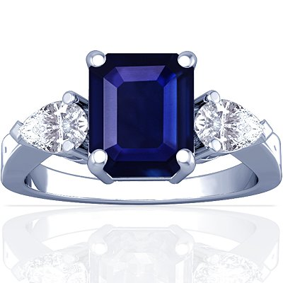 Platinum Emerald Cut Blue Sapphire Three Stone Ring