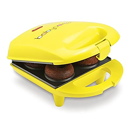 BABYCAKES Mini Donut Maker Make 4 Mini Donuts With Non-Stick Baking Plates Latching Handle and Non-Skid Rubber Feet.