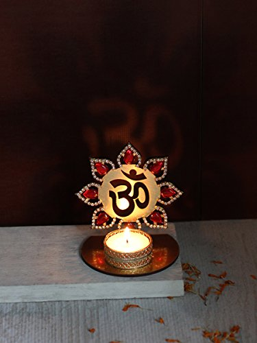 store-indya-floral-om-with-shubh-labh-gold-accented-tea-light-holder-for-festive-occasions