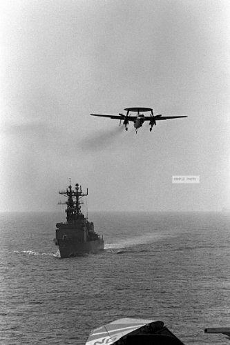 Photo An E-2C Hawkeye Airborne Early Warning Aircraft Makes A Final Approach For The Flight Deck Of The Aircraft Carrier Uss Ranger (Cv-61). The Spruance Class Destroyer Uss Fletcher (Dd-992) Is Underway In The Background, 05/14/1983