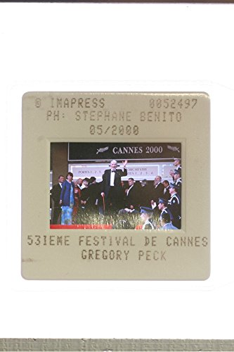 slides-photo-of-american-actor-gregory-peck-replied-greets-to-fans-by-waving-hand-at-2000-cannes-fil