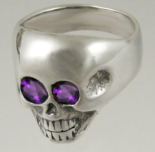 A Striking Sterling Silver Skull Featuring Two Faceted Amethyst Gemstone Eyes