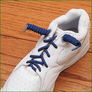 a white trainer with blue no tie shoelaces in