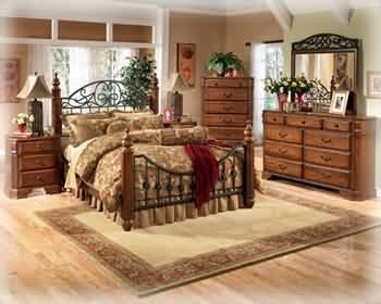 ashley-wyatt-iron-poster-queen-size-bedroom-set-in-rich-oak-finish