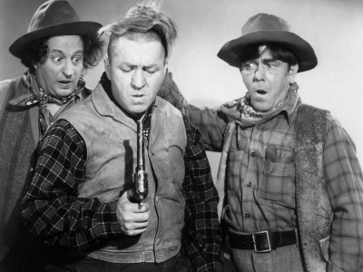 The Three Stooges - Larry, Curly, Moe - in cowboy garb for a Western short film
